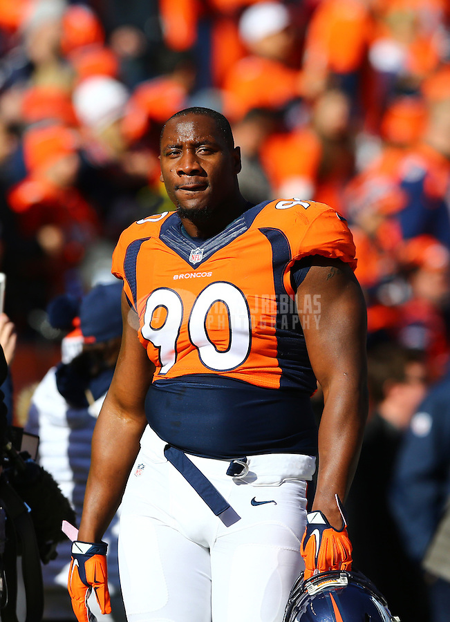 Jan 24, 2016; Denver, CO, USA; Denver Broncos defensive end Antonio Smith (90) against the New England Patriots in the AFC Championship football game at Sports Authority Field at Mile High. The Broncos defeated the Patriots 20-18 to advance to the Super Bowl. Mandatory Credit: Mark J. Rebilas-USA TODAY Sports