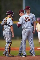 Central Michigan Chippewas pitching coach Jeff Opalewski (26) talks with catcher Robert Greenman (23) and pitcher Grant Wolfram (30) during a game against the Boston College Eagles on March 8, 2016 at North Charlotte Regional Park in Port Charlotte, Florida.  Boston College defeated Central Michigan 9-3.  (Mike Janes/Four Seam Images)