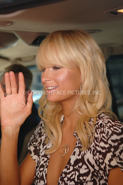WWW.ACEPIXS.COM . . .  ....June 13 2006, New York City....Paris Hilton signs autographs for fans as she leaves the Regis and Kelly show.....Please byline: PHILIP VAUGHAN - ACEPIXS.COM.. *** ***  ..Ace Pictures, Inc:  ..(212) 243-8787..e-mail: info@acepixs.com..web: http://www.acepixs.com