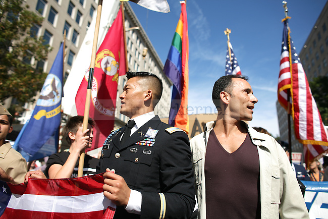 """Lt. Dan Choi, left, walks with his partner, Matthew Kinsey during the National Equality March to fight for equal rights for the LGBTQ community in Washington, D.C. on Sunday. On Saturday, President Obama vowed to end the """"Don't Ask, Don't Tell"""" policy during an annual dinner of the Human Rights Campaign in Washington. Photo by Adam Wolffbrandt 