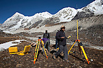 Dr Shresth Tayal, Glaciologist at The Energy and Resources Institute (TERI) sets part of his measuring equipment up at the fast reducing Rathong Glacier (at bottom left of frame) below the 6678 meter Rathong Peak in the North East Indian state of Sikkim close to the Nepalese border. Considered to be a themometre of the environment, it has been chosen by TERI to be a test case of environmental damage being done in India and China. Dr. Tayal is conducting three dimensional tests that include measuring the depth of the ice to form concrete conclusions on the fate of the glacier.The Indian Government is denying the glaciers' demise despite data suggesting it has been reduced by more than over 80% in the last 42 years.