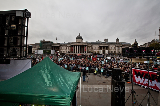 """London, 08/10/2011. Today Trafalgar Square was the stage of the """"Antiwar Mass Assembly"""" organised by The Stop The War Coalition to mark the 10th Anniversary of the invasion of Afghanistan. Thousands of people gathered in the square to listen to speeches given by journalists, activists, politicians, trade union leaders, MPs, ex-soldiers, relatives and parents of soldiers and civilians killed during the conflict, and to see the performances of actors, musicians, writers, filmmakers and artists. The speakers, among others, included: Jeremy Corbin, Joe Glenton, Seumas Milne, Brian Eno, Sukri Sultan and Shadia Edwards-Dashti, Hetty Bower, Mark Cambell, Sanum Ghafoor, Andrew Murray, Lauren Booth, Kate Hudson, Sami Ramadani, Yvone Ridley, Mark Rylance, Dave Randall, Roger Lloyd-Pack, Rebecca Thorn, Sanasino al Yemen, Elvis McGonagall, Lowkey (Kareem Dennis), Tony Benn, John Hilary, Bruce Kent, John Pilger, Billy Hayes, Alison Louise Kennedy, Joan Humpheries, Jemima Khan, Julian Assange, Lindsey German, George Galloway. At the end of the speeches a group of protesters marched toward Downing Street where after a peaceful occupation the police made some arrests."""