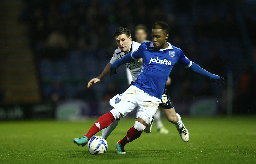 Portsmouth's Mustapha Dumbuya and Preston North End's David Buchanan in action during todays match  ..Football - npower Football League Division One - Portsmouth v Preston North End - Saturday 15th December 2012 - Fratton Park - Portsmouth..