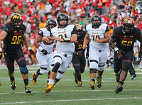 College Park, MD - September 9, 2017: Towson Tigers quarterback Ryan Stover (21) slides for a first down during game between Towson and Maryland at  Capital One Field at Maryland Stadium in College Park, MD.  (Photo by Elliott Brown/Media Images International)