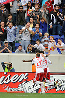 Juan Pablo Angel (9) of the New York Red Bulls celebrates scoring the game winning goal with Joel Lindpere (20) and Ibrahim Salou (29). The New York Red Bulls defeated the Philadelphia Union 2-1 during a Major League Soccer (MLS) match at Red Bull Arena in Harrison, NJ, on April 24, 2010.