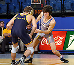 BROOKINGS, SD - NOVEMBER 9:  Will James from South Dakota State looks to battle David Peatce from Drexel in their 133 pound match Saturday at Frost Arena. (Photo by Dave Eggen/Inertia)