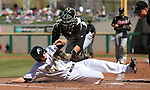 Sacramento River Cats' Stephen Vogt tags out Reno Aces' Chris Owings during the Reno Aces baseball game in Reno, Nev., on Sunday, April 14, 2013. Owings went 4-4 on the day, but the River Cats won 22-6..Photo by Cathleen Allison