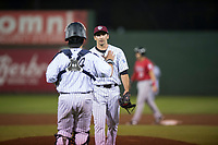 Idaho Falls Chukars relief pitcher Ted Cillis (24) is congratulated by Chase Vallot (44) after recording the final out of a Pioneer League game against the Billings Mustangs at Melaleuca Field on August 22, 2018 in Idaho Falls, Idaho. The Idaho Falls Chukars defeated the Billings Mustangs by a score of 5-3. (Zachary Lucy/Four Seam Images)