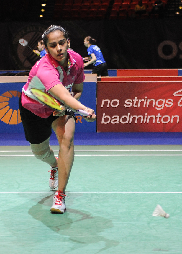 Saina NEHWAL [2] [IND]  in action today during her victory over Shixian WANG [6] [CHN]   in their Woman's singles quarter final match. Saina NEHWAL [2] [IND] bt Shixian WANG [6] [CHN]  23-21 19-21 21-16...BWF -  2013 Yonex All England Badminton Championships Super Series Premier - The National Indoor Arena - Birmingham - England - Friday 08th March 2013..© CameraSport - 43 Linden Ave. Countesthorpe. Leicester. England. LE8 5PG - Tel: +44 (0) 116 277 4147 - admin@camerasport.com - www.camerasport.com