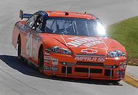 Mar 30, 2007; Martinsville, VA, USA; Nascar Nextel Cup Series driver Tony Stewart (20) during practice for the Goody's Cool Orange 500 at Martinsville Speedway. Martinsville marks the second race for the new car of tomorrow. Mandatory Credit: Mark J. Rebilas