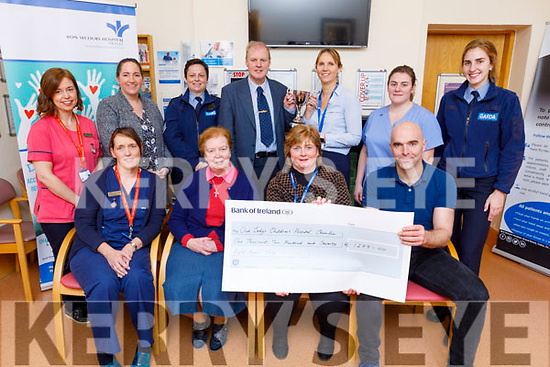 Members of the Tralee Garda District present a cheque for €1,278:00 to Our Lady's Children's Hospital, Crumlin in the Bons Secure Hospital in Tralee on Saturday. The proceeds from a recent soccer challenge game between the Tralee Garda and the Bons Hospital.  <br /> Seated l to r: Colette Mc Hale, Sr Anita, Mary Healy and Sgt Tom Burke.<br /> Standing l to r: Sandra Curran, Clare Dennehy, Sgt Bridget Foley, Mike Healy, Olivia Rahilly (Director of Nursing), Sinead Kerins and Gda Leanne Houseman
