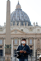 Saint Peter will be closed to the tourists since today. Tourists watch at the basilic wearing masks<br /> Rome March 10th 2020. Rome the day after the last Minister Council's decree, that extends the restrictions from North of Italy to the entire country to contain Covid-19 Virus. All the shops (restaurants, pubs, and even supermarkets) will have to close at 6 pm. Gathering of people will be forbitten and people will have to maintain the 1 meter security distance. Citizens are furthermore invited to stay at home with the exception of people who have to go to work, to the pharmacy or to the supermarket.<br /> Photo Samantha Zucchi Insidefoto