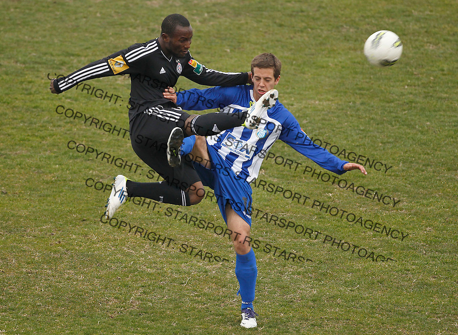 Fudbal, Jelen super liga, season 2011/2012.OFK Beograd Vs. Partizan.Mohamed Medo Kamara left and Marko Pavlovski.Beograd, 14.03.2012..Srdjan Stevanovic/Starsportphoto ©