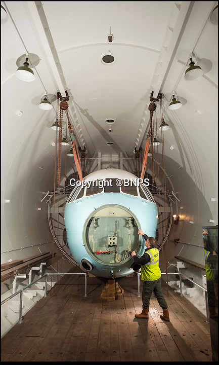 BNPS.co.uk (01202 558833)<br /> Pic: PhilYeomans/BNPS<br /> <br /> The cockpit from a Viscount is suspended in the huge chamber..<br /> <br /> The coldest of Cold War relics has opened to the public after years of secrecy. <br /> <br /> Barnes Wallis's amazing Stratosphere Chamber was built at Brooklands in 1947 to test aircraft in high altitude conditions of flight.<br /> <br /> Constructed from the hull of a nuclear submarine the 340 ton structure could replicate temperatures down to -60 centigrade at 60,000 feet, as well as blasting rain, sleet or snow at 40 kts through the sealed chamber.<br /> <br /> As well as aircraft the facility was also used to test naval equipment in freezing arctic conditions, and even the effects of icing on trawler rigging.<br /> <br /> The gigantic structure, containing the cockpit of a Viscount passenger aircraft, has now been spruced up and is open to the public at the Brooklands Museum in Weybridge.