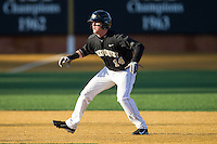 Conor Keniry (14) of the Wake Forest Demon Deacons takes his lead off of second base against the Georgetown Hoyas at Wake Forest Baseball Park on February 16, 2014 in Winston-Salem, North Carolina.  The Demon Deacons defeated the Hoyas 3-2.  (Brian Westerholt/Four Seam Images)