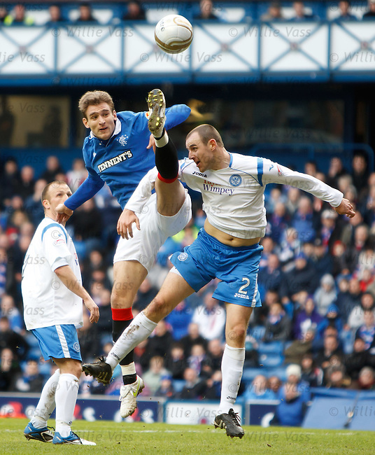 Nikica Jelavic high kicks to collect the ball from Dave Mackay