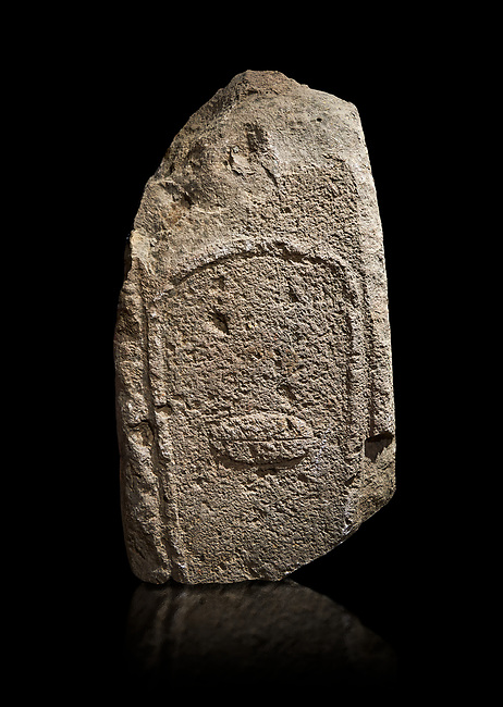 Late European Neolithic prehistoric Menhir standing stone with carvings on its face side. Excavated from Amassed VII, Allai.  Menhir Museum, Museo della Statuaria Prehistorica in Sardegna, Museum of Prehoistoric Sardinian Statues, Palazzo Aymerich, Laconi, Sardinia, Italy. Black background.