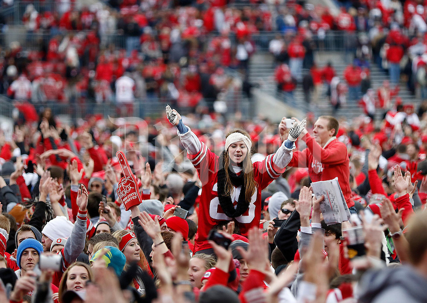 Fans take to the field following the NCAA football game against Michigan at Ohio Stadium on Saturday, November 29, 2014. (Columbus Dispatch photo by Jonathan Quilter)