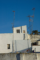 Crooked TV Aerials on rooftops at sunrise, Tarifa, Andalusia, Spain.