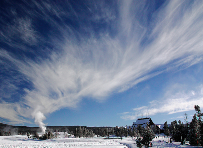 Steam from Old Faithful Geyser fills the sky at Yellowstone National Park, Wyoming