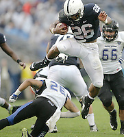 State College, PA - 09/12/2015:  Penn State freshman RB Saquon Barkley (26) hurdles Buffalo defender Ryan Williamson (26) during a run. Barkley led PSU rushers with 12 carries for 115 yards and 1 touchdown. Penn State defeated Buffalo by a score of 27-14 at rainy Beaver Stadium in University Park, PA.<br /> <br /> Photos by Joe Rokita / JoeRokita.com
