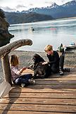 USA, Alaska, Homer, China Poot Bay, Kachemak Bay, children playing on the dock at the Kachemak Bay Wilderness Lodge