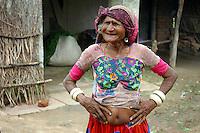 A woman in traditional dress, including ivory bracelets...by Michael Benanav - mbenanav@gmail.com