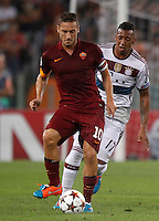 Calcio, Champions League, Gruppo E: Roma vs Bayern Monaco. Roma, stadio Olimpico, 21 ottobre 2014.<br /> Roma's Francesco Totti is challenged by Bayern's Jerome Boateng, right, during the Group E Champions League football match between AS Roma and Bayern at Rome's Olympic stadium, 21 October 2014.<br /> UPDATE IMAGES PRESS/Isabella Bonotto