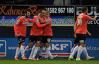 Paul Benson of Luton Town (centre) celebrates his opening goal during the Sky Bet League 2 match between Luton Town and Northampton Town at Kenilworth Road, Luton, England on 12 December 2015. Photo by Liam Smith/Prime Media Images.