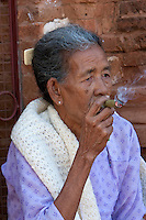 Myanmar, Burma.  Bagan Woman Smoking a Cigar.