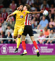 Morecambe's Vadaine Oliver vies for possession with Lincoln City's Rob Dickie<br /> <br /> Photographer Chris Vaughan/CameraSport<br /> <br /> The EFL Sky Bet League Two - Lincoln City v Morecambe - Saturday August 12th 2017 - Sincil Bank - Lincoln<br /> <br /> World Copyright &copy; 2017 CameraSport. All rights reserved. 43 Linden Ave. Countesthorpe. Leicester. England. LE8 5PG - Tel: +44 (0) 116 277 4147 - admin@camerasport.com - www.camerasport.com