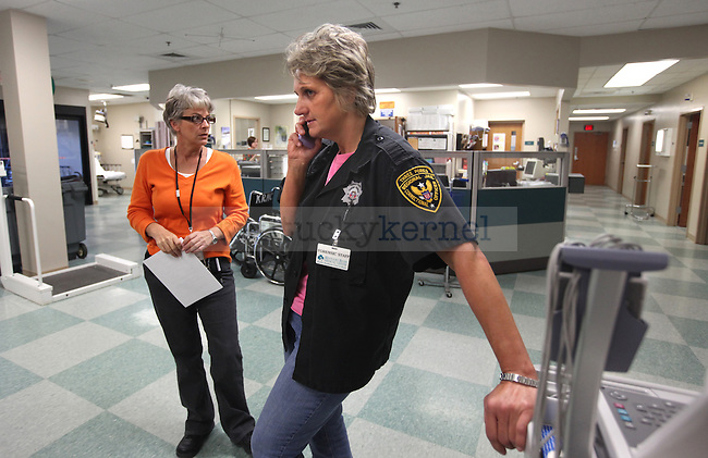 Officer Kay Chambers calls back to Three Forks Regional Jail after hearing word that Amanda Driggers' baby will be fine. Photo by Britney McIntosh