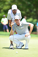 Bethesda, MD - June 26, 2016: Webb Simpson (USA) and his caddy line up a shot on the first hole during Final Round of play at the Quicken Loans National Tournament at the Congressional Country Club in Bethesda, MD, June 26, 2016. (Photo by Philip Peters/Media Images International)