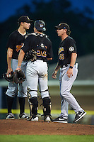 West Virginia Black Bears pitching coach Mark DeFelice (45) talks with pitcher Stephan Meyer (31) and catcher Arden Pabst (52) during a game against the Batavia Muckdogs on August 20, 2016 at Dwyer Stadium in Batavia, New York.  Batavia defeated West Virginia 7-2.  (Mike Janes/Four Seam Images)
