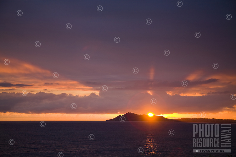 Sunset over the Diamond Head, seen from the East at Portlock, with ocean in foreground