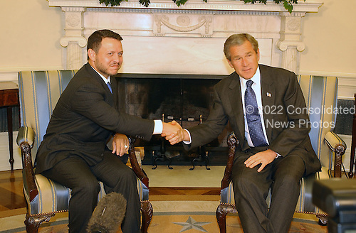 United States President George W. Bush shakes hands with King Abdullah II of Jordan in the Oval Office of the White House in Washington, D.C. on August 1, 2002..Credit: Ron Sachs / CNP