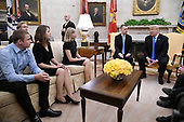 U.S. President Donald Trump meets with Pastor Andrew Brunson and his family in the Oval Office of the White House on October 13, 2018 in Washington, DC. Pastor Andrew Brunson arrived back in the U.S. on Saturday after being held in Turkey for two years on terrorism charges. <br /> Credit: Olivier Douliery / Pool via CNP