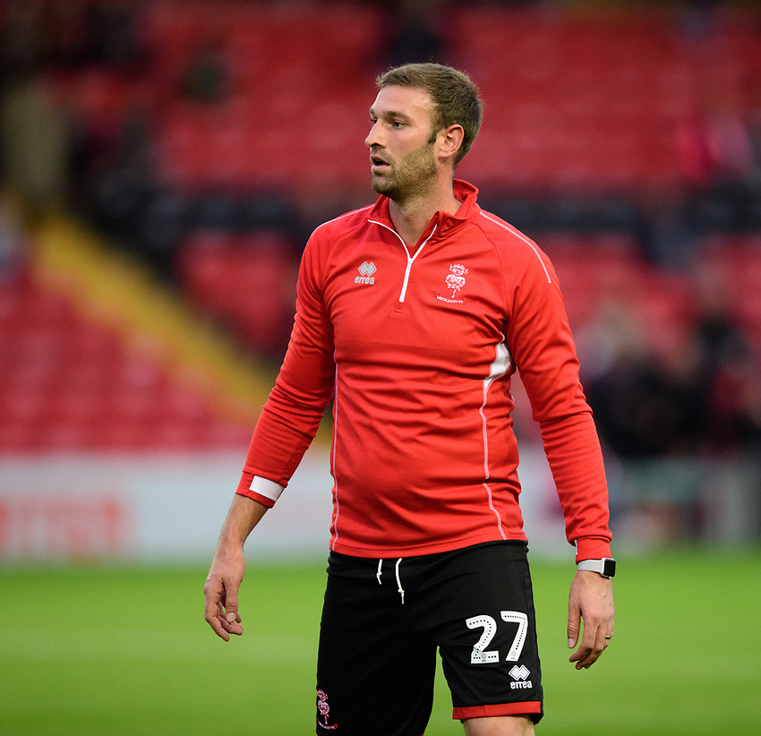 Lincoln City's Jamie McCombe during the pre-match warm-up<br /> <br /> Photographer Chris Vaughan/CameraSport<br /> <br /> The EFL Checkatrade Trophy Group H - Lincoln City v Mansfield Town - Tuesday September 4th 2018 - Sincil Bank - Lincoln<br />  <br /> World Copyright © 2018 CameraSport. All rights reserved. 43 Linden Ave. Countesthorpe. Leicester. England. LE8 5PG - Tel: +44 (0) 116 277 4147 - admin@camerasport.com - www.camerasport.com