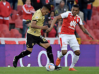 BOGOTÁ - COLOMBIA, 08-04-2018: Almir Soto (Der.) jugador de Santa Fe disputa el balón con Jhonny Vasquez (Izq.) jugador del Rionegro durante el encuentro entre Independiente Santa Fe y Rionegro Águilas por la fecha 13 de la Liga Águila I 2018 jugado en el estadio Nemesio Camacho El Campin de la ciudad de Bogotá. / Almir Soto (R) player of Santa Fe struggles for the ball with Jhonny Vasquez (L) player of Rionegro during match between Independiente Santa Fe and Rionegro Aguilas for the date 13 of the Aguila League I 2018 played at the Nemesio Camacho El Campin Stadium in Bogota city. Photo: VizzorImage/ Gabriel Aponte / Staff