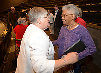 NWA Democrat-Gazette/ANDY SHUPE<br /> Longtime educator Faye Jones (left) greets Peggy Taylor Lewis, who was one of the first black students to graduate from Fayetteville High School, Thursday, Oct. 11, 2018, before the start of a presentation by the four Fayetteville Public Schools Hall of Honor inductees in the Performing Arts Center on the Fayetteville High School campus. Also inducted were pediatric dentist James Hunt and beloved educator George Spencer.