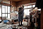 Mr Dai come back to his home after 3 days form the Tsunami. Since then he start to clean up and trow outside all the stuff the Tsunami brought in his house. After 6 days form the Tsunami he can actually stand in his living room. The kitchen is completely destroyed although.