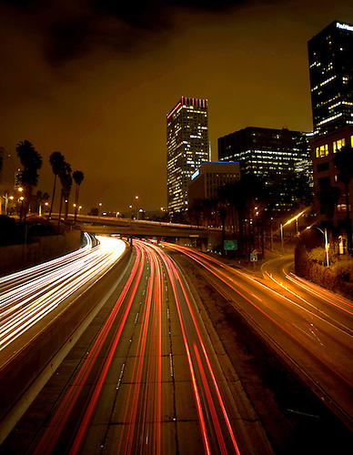 Traffic passes by during rush hour in downtown Los Angeles