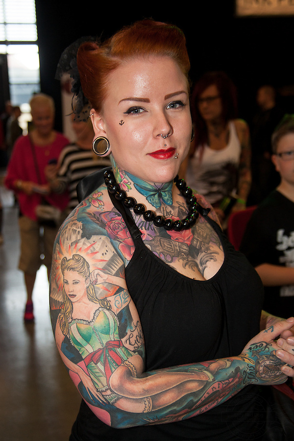 Tattoo. Snapshots from Copenhagen Ink Festival 2013. Bourlesque theme on arm and back.