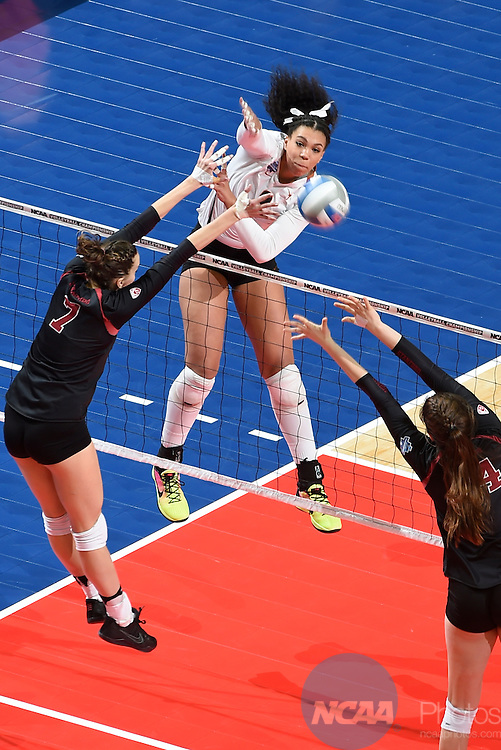 COLUMBUS, OH - DECEMBER 17:  Ebony Nwanebu (2) of the University of Texas attempts a kill against Stanford University during the Division I Women's Volleyball Championship held at Nationwide Arena on December 17, 2016 in Columbus, Ohio.  Stanford defeated Texas 3-1 to win the national title. (Photo by Jamie Schwaberow/NCAA Photos via Getty Images)