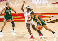 COLLEGE PARK, MD - DECEMBER 8: Alexis Gray #20 of Loyola moves past Ashley Owusu #15 of Maryland during a game between Loyola University and University of Maryland at Xfinity Center on December 8, 2019 in College Park, Maryland.