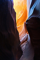 Golden reflected light enhances the lines of sandstone erosion in the Antelope Slot Canyon near Lake Powell and Page Arizona