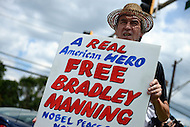 July 30, 2013  (Fort Meade, Maryland) Max Obuszewski, of Baltimore, MD, holds a sign supporting Army Private Bradley Manning outside the main gate of Fort Meade after the judge in Manning's trial found him not guilty of aiding the enemy. Manning was found guilty on several other charges   (Photo by Don Baxter/Media Images International)
