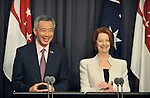 Singapore Prime Minister Lee Hsien Loong (left) speaks during a press conference with Australian Prime Minister Julia Gillard (right) at Parliament House, Canberra, Thursday October 11th 2012. AFP PHOTO / Mark GRAHAM