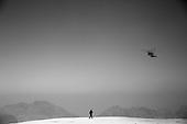 A United States Secret Service agent stands watch as Marine One descends towards a landing zone near Petra, Jordan, March 23, 2013. .Mandatory Credit: Pete Souza - White House via CNP