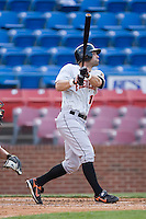 Brandon Tripp (12) of the Frederick Keys follows through on his swing versus the Winston-Salem Warthogs at Ernie Shore Field in Winston-Salem, NC, Saturday, June 7, 2008.